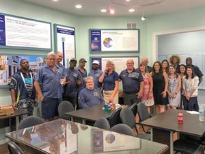 Dale Sorensen Real Estate hosts lunch for Golf Carts of Vero Beach following fire