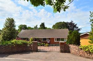 Superb bungalow with stunning landscaped gardens extending to two thirds of an acre.