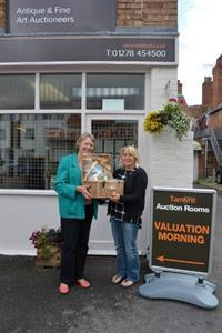 Dunster Show competition winner collects her prize