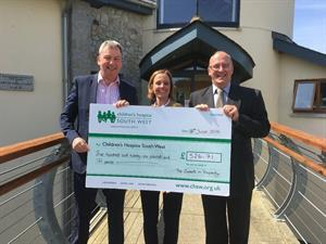 Fundraising cheque for Childrens Hospice SouthWest from Lewis and Co